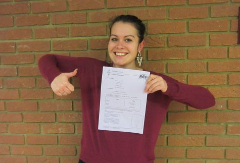 Kelly with her pass certificate